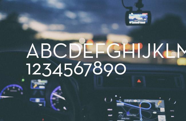 Uppsala taxis nya typsnitt mot foto på instrumentbräda.